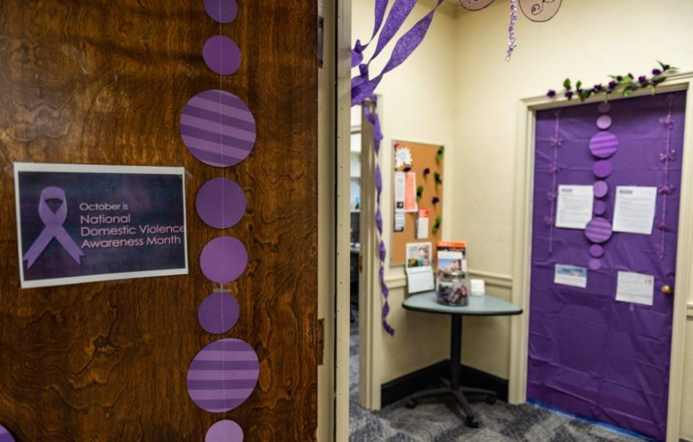 purple decor and sign in office
