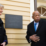 """Harvard President Drew Faust and Congressman John Lewis unveil a plaque memorializing four slaves who lived and worked in Wadsworth House during the 1700s. """"We name the names to remember those stolen lives,"""" said Faust. Photo by Rose Lincoln/Harvard Staff Photographer"""