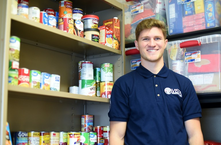 A portrait of AmeriCorps VISTA member Rob Felger in the Penn State Behrend Lion's Pantry.