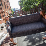 Students carrying a couch