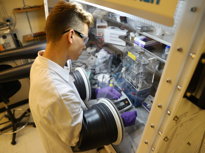 man working in lab with equipment