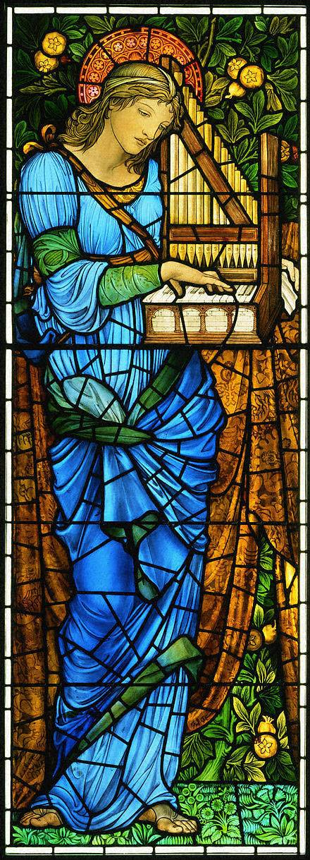 Stained glass window featuring a woman reading a book