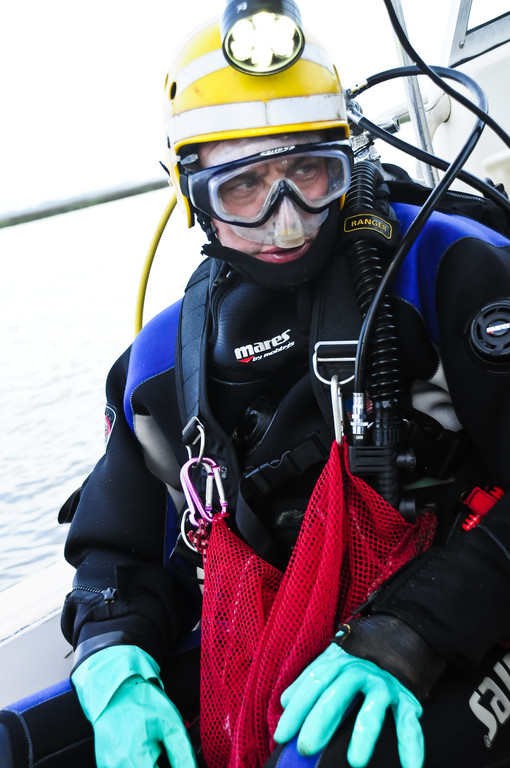 Scuba diver Bill Eberlein prepares to enter the water.