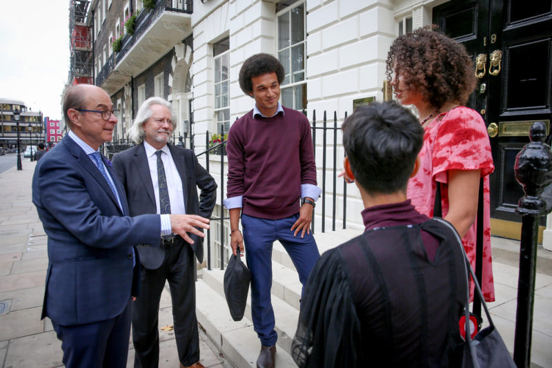 Northeastern President Joseph E. Aoun, left, and NCH Founder and Master Anthony Grayling talk to students on the campus in London on Thursday, Sept. 19, 2018. Photo by Suzanne Plunkett for Northeastern University