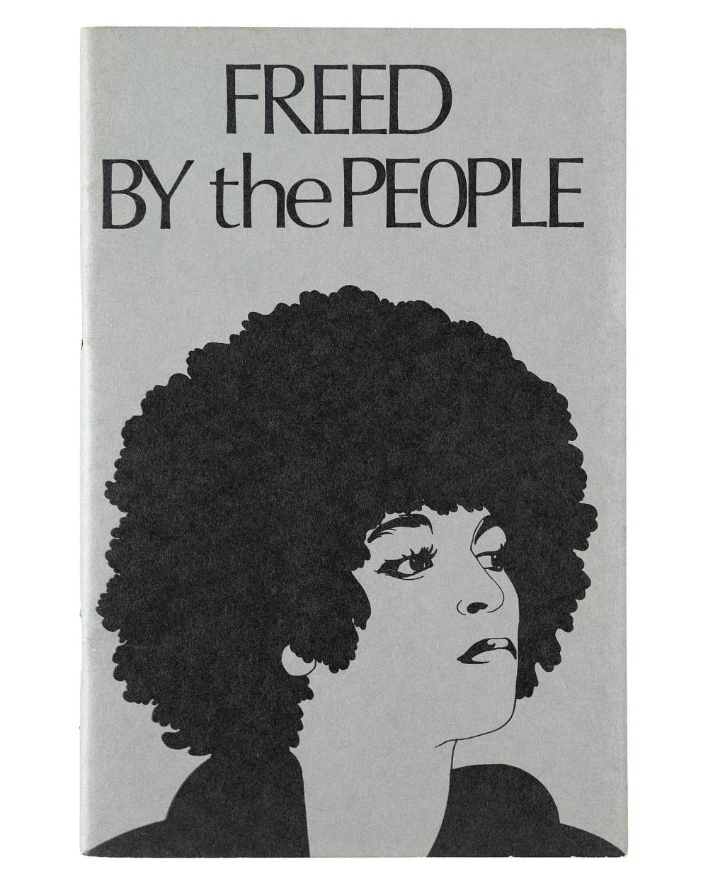 "A gray pamphlet with an illustration of Angela Davis and ""Freed by the People"" in black text."