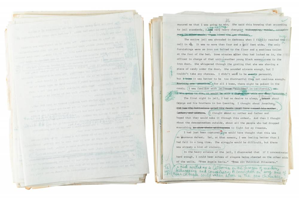 A manuscript with edits written in blue pen.