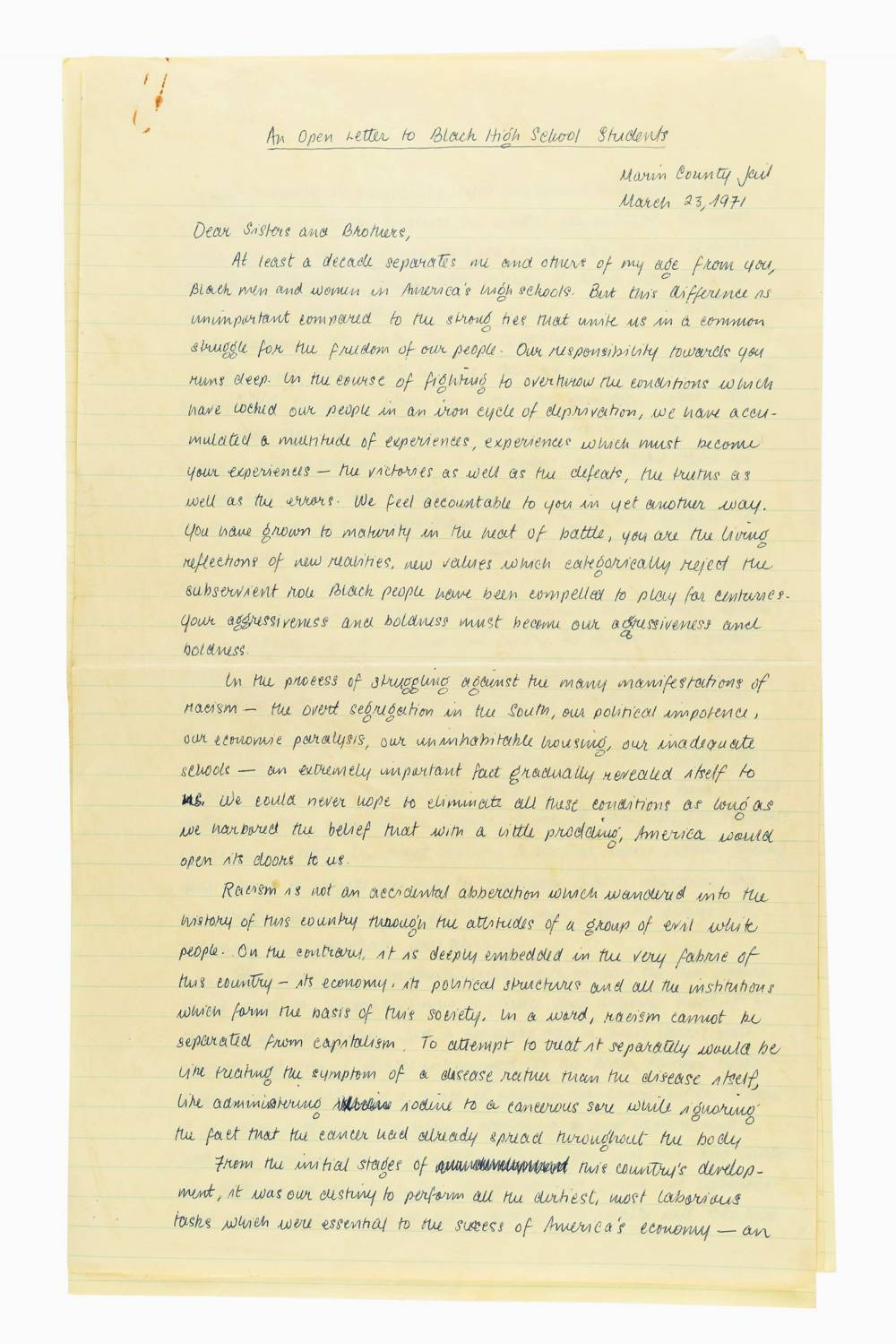 A handwritten letter on yellowed, lined paper.