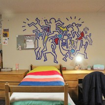 "Ange Long, a first-year student studying architecture, created this Keith Haring-inspired wall art with painter's tape and tissue paper. She along with fellow first-year students Esther Faronbi, who is at the McKelvey School, and Arsema Belai, an Arts & Sciences student, won the prize for ""best triple room."" (Photo courtesy of Faronbi)"