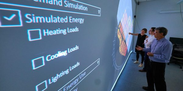 faculty members collaborate on building energy project