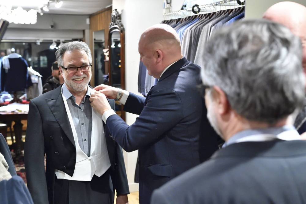 Gregg Semenza is fitted for a white tie tuxedo