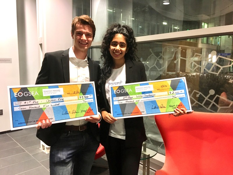 two students pose with competition winnings