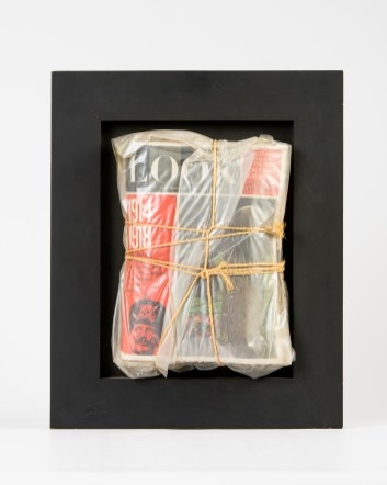 "Christo, ""Look,"" 1965. Magazine wrapped in plastic and cord on painted wood. Published by Edition MAT / Galerie Der Spiegel, Cologne. Courtesy Ludwig Museum Koblenz, Germany. © 2019 Christo."