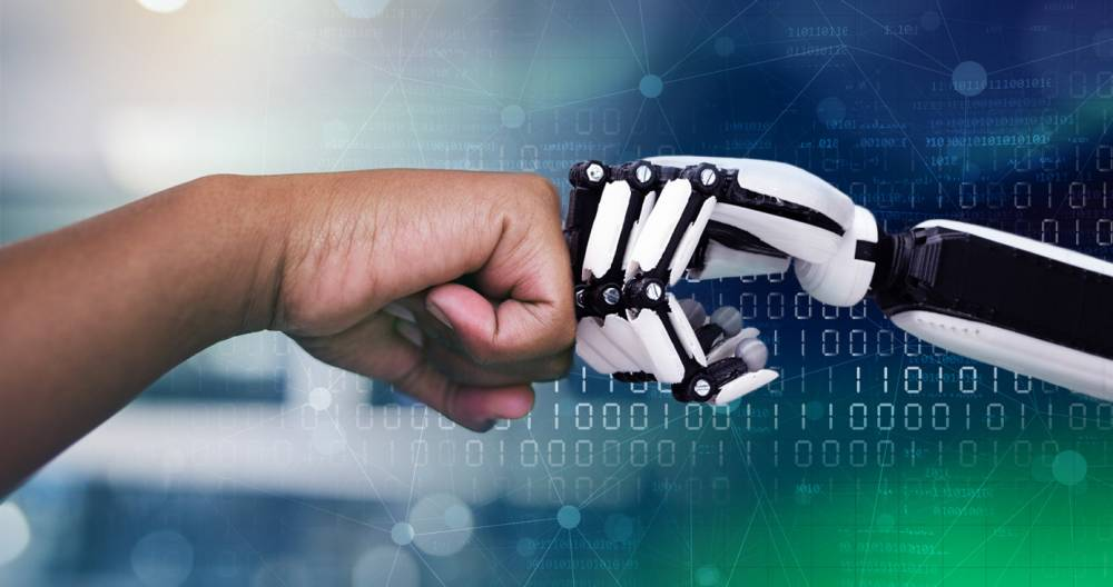 A human and a robot fist bumping