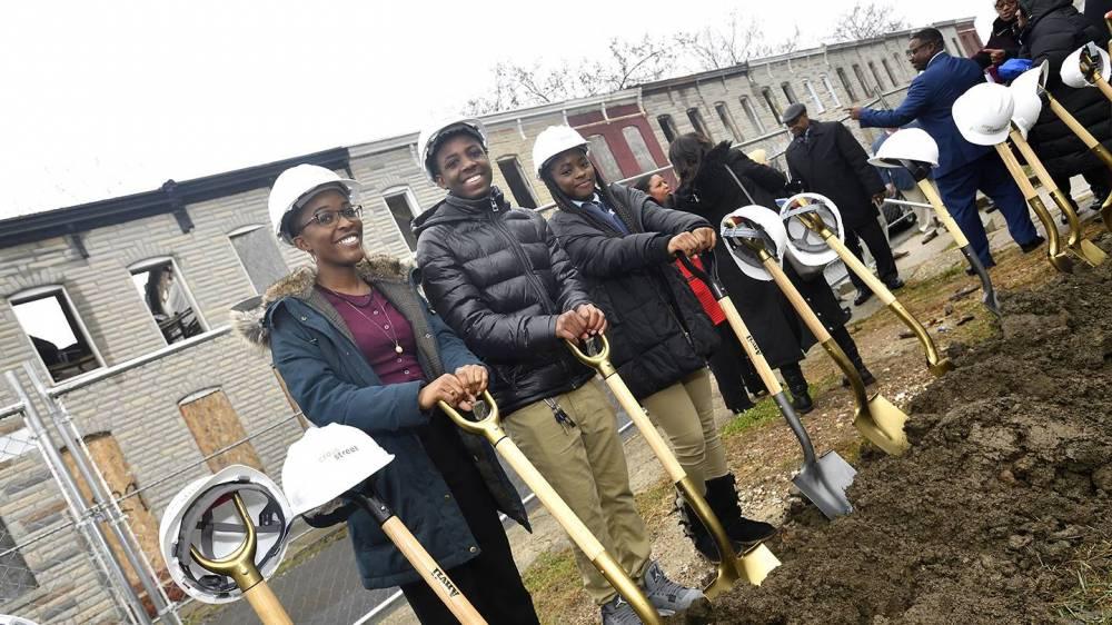 Photo of students holding shovels