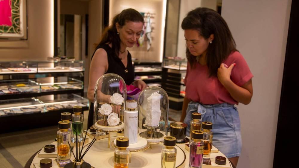 Students looking at perfume samples