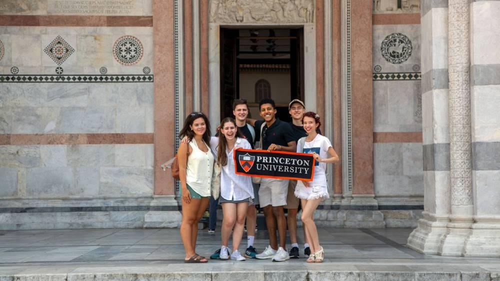 Students standing holding Princeton University banner