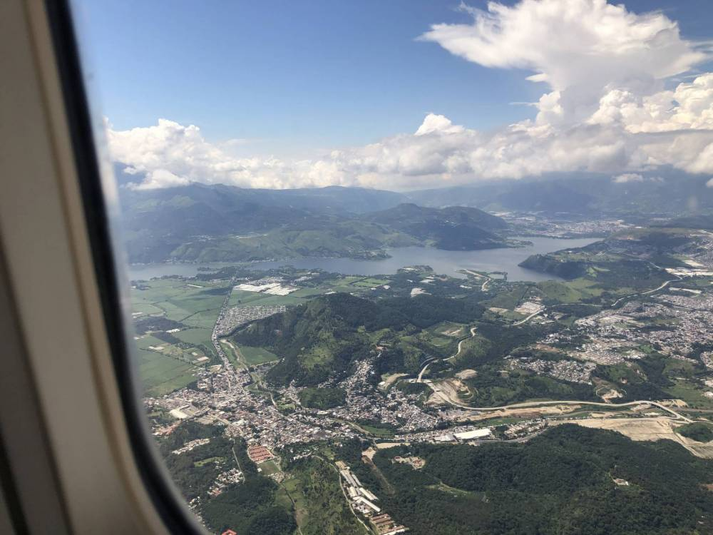 View out of the plane window, looking down on the Antigua Valley