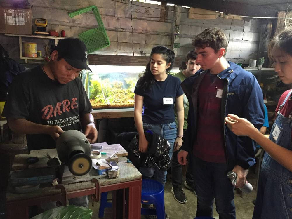 Students watch a silversmith at work
