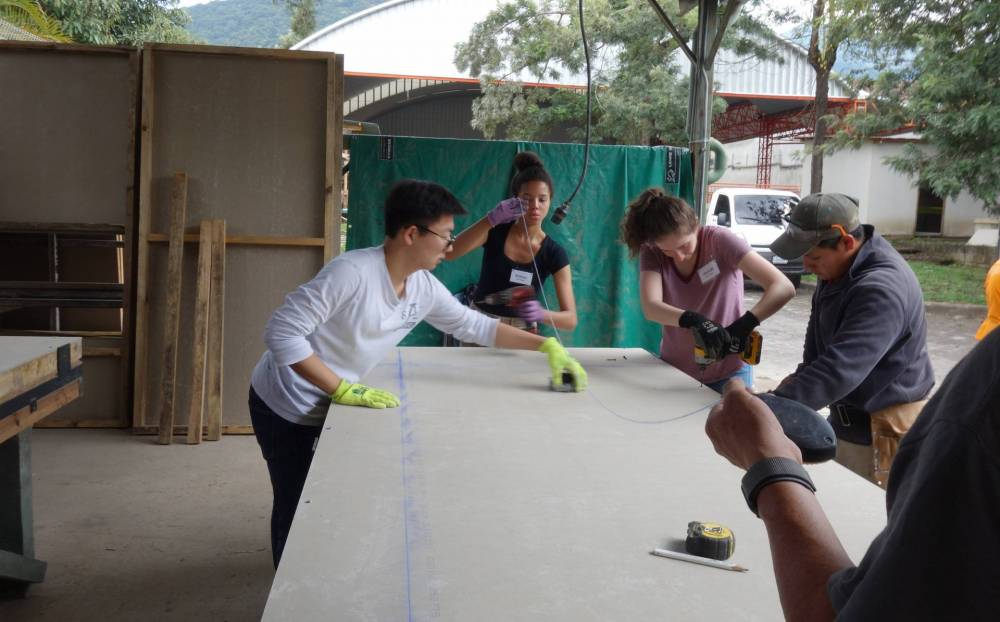 3 students involved in a construction task