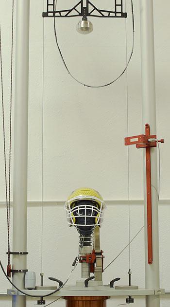 helmet in testing machine
