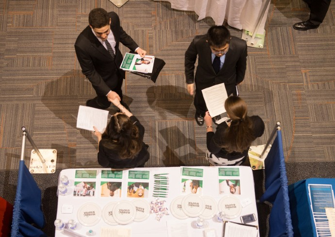 aerial view of students speaking with recruiters