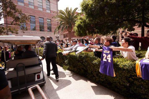 Kobe Bryant walks past fans at USC