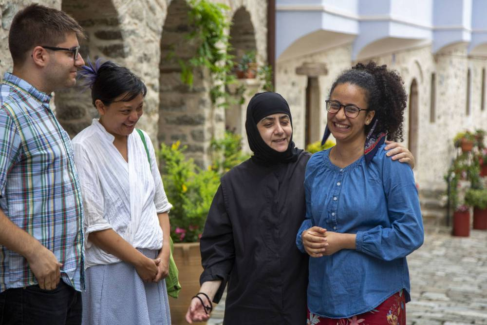 Students interact with a nun