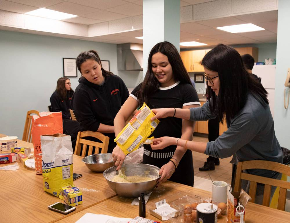Students mixing batter for banana bread
