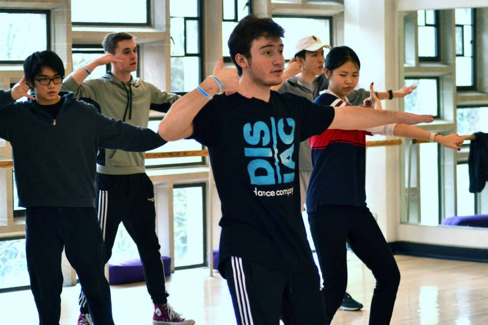 Students are led through dance choreography