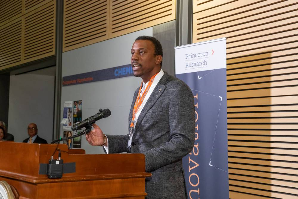 Rodney Priestley speaks at a podium during an event