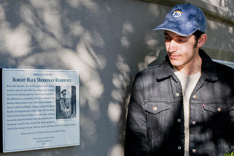 Student Milton Zerman looks at a plaque he sponsored for a Berkeley Ph.D. student who fought in the Spanish Civil War.
