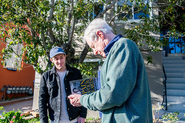 Student Milton Zerman and lecturer Adam Hochschild recently visited the historical plaque honoring Spanish Civil War hero Robert Merriman.