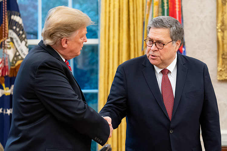U.S. President Donald Trump shakes hands with Attorney General William Barr after Barr was sworn in on Feb. 14, 2019