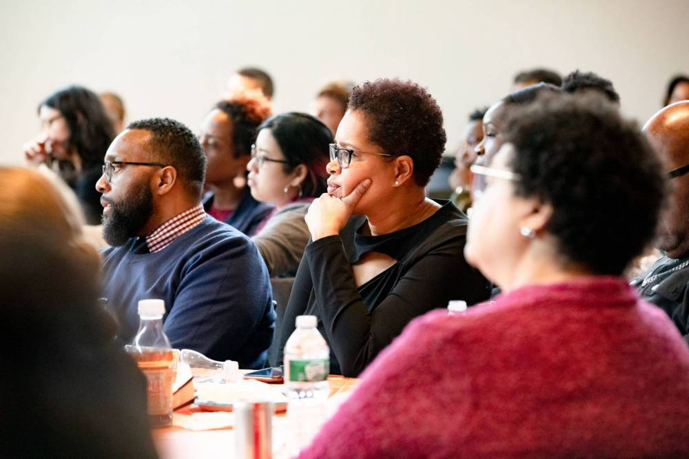 Members of Princetonians of Color Network listen intently