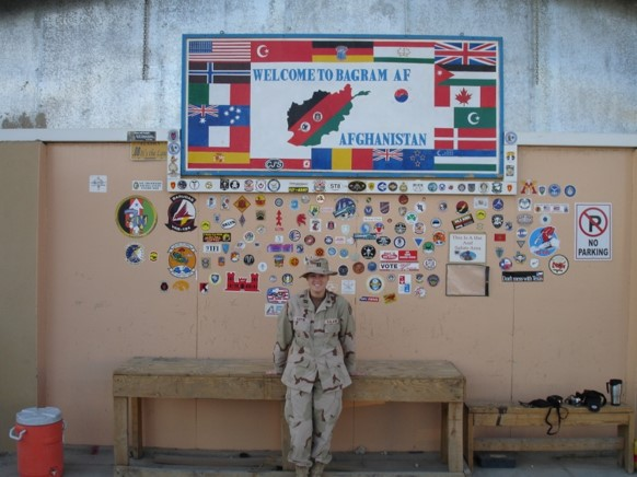 soldier in front of banner