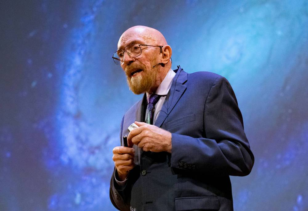 Kip Thorne in front of a projected image of the Milky Way