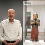 Walter Sedgwick stands next to Japanese statue