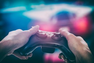 person holding video game controller