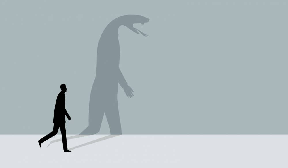 An illustration of a man walking, and his shadow shows the figure of a snake. Credit: iStock/dane_mark