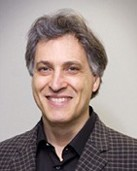 Headshot of Brian Uzzi, creator of COVID-19 AI model