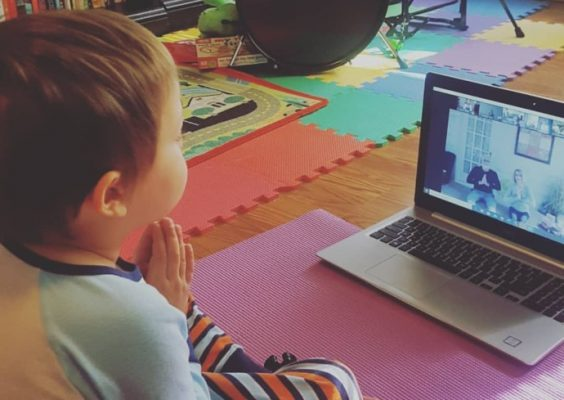 a child watching an online yoga video