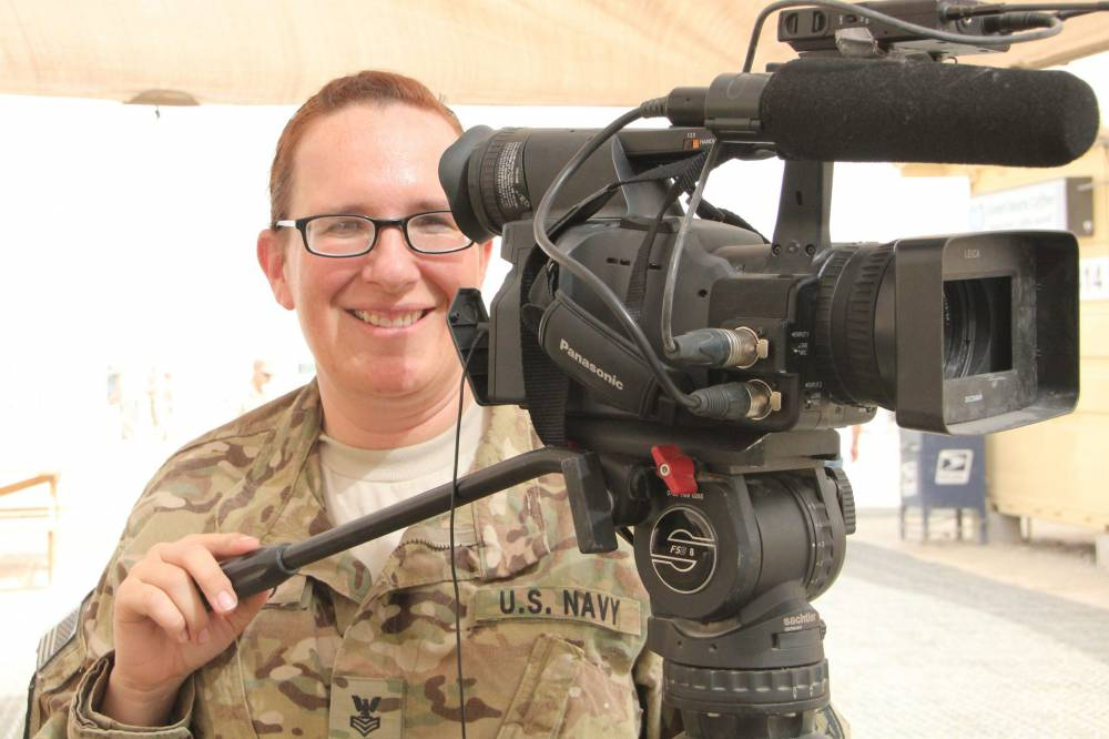 woman in uniform with video camera