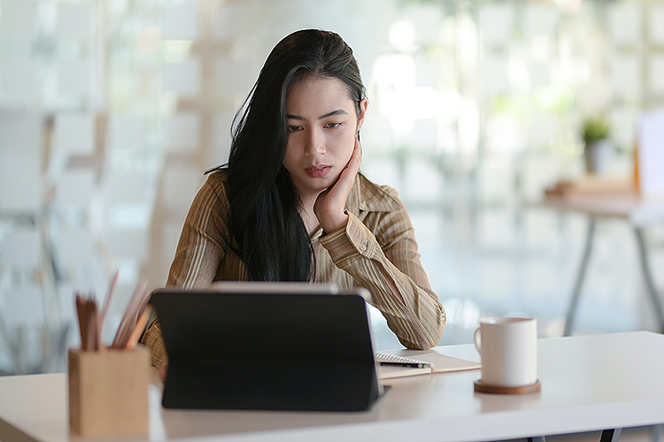 Woman seated before a computer screen