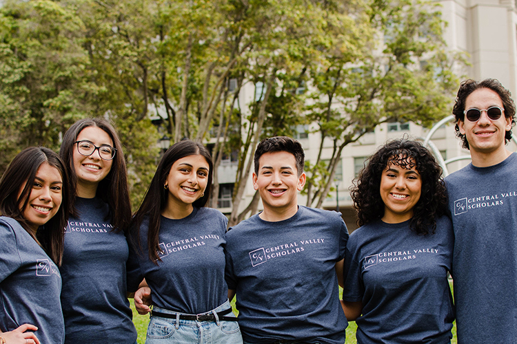 The Central Valley Scholars team, in matching t-shirts, stand with their arms around each other.
