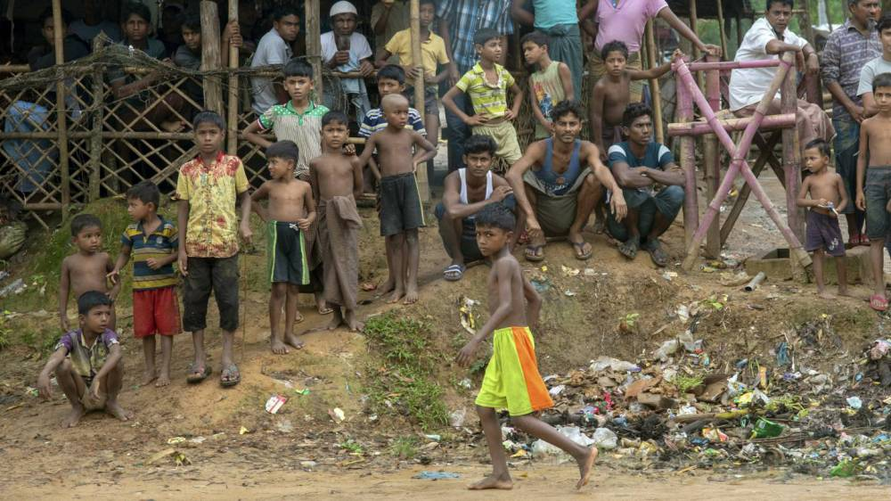 Rohingya men and boys gather together for a photograph