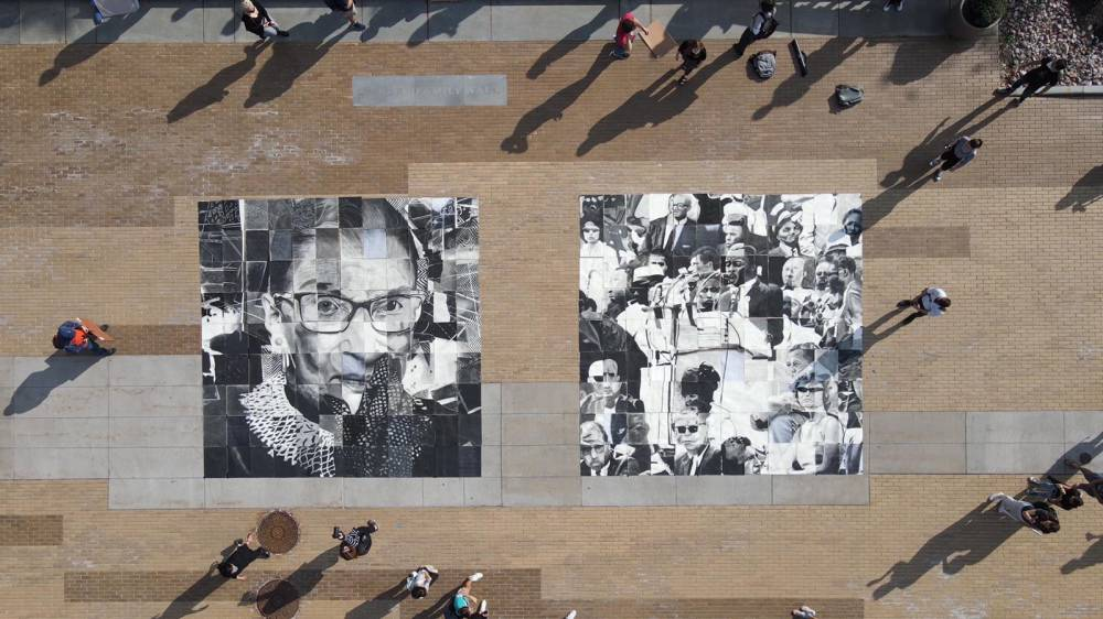 students surround a mosaic of drawings on the Einhorn Family Walk