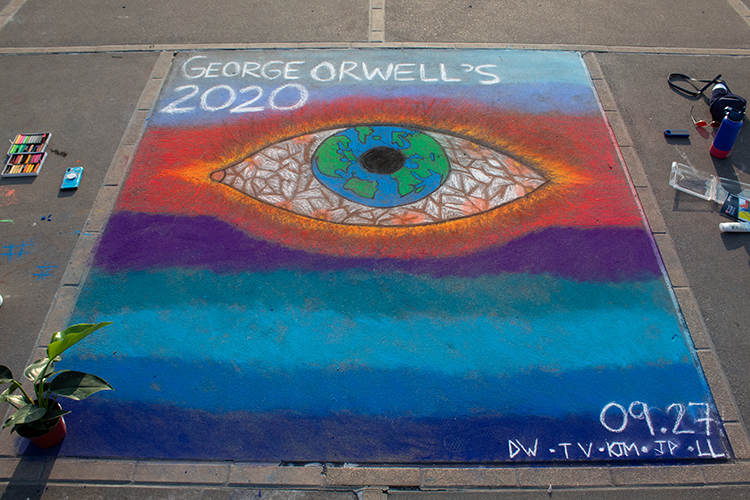 Students painted on the ground with chalk