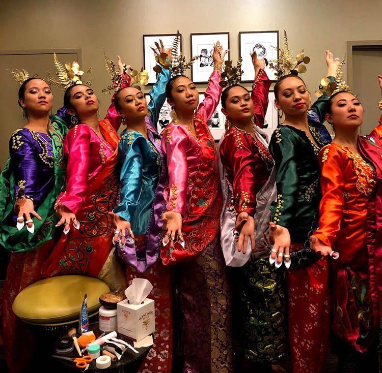 Katalina Cortezt poses in traditional cultural dance attire with dance group