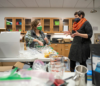 Assistant Professor of Anthropology Cara Ocobock (right) and PhD student Hannah Wesselman chat in the lab where the kits were assembled.