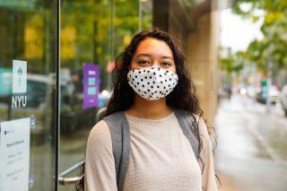 NYU student wearing a mask.